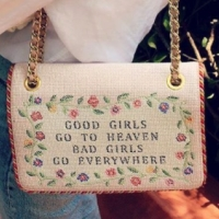 """Emma Roberts's needlepoint """"bad girls"""" purse is the edgy grandma accessory you need"""