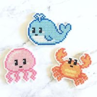 🐠🐠🐠 Hope no one's tired of seeing these yet 😋 Think I'm going to put these in my #etsyshop soon, it needs expanding anyways Which one's your fave? . . . . #crossstitch #embroidery #pixelart #pixel #xstitch #PlasticCanvas #charms #keychains #cute #kawaii #whale #jellyfish #crab #sea #ocean #creatures #dmc #stitchfiddle