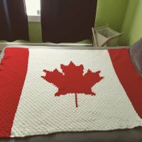 Another #c2ccrochet #canadianflagblanket done. Graph made and charted out by me with @stitchfiddle size full/queen. Pictured on a queen sized bed. . . . #nnchandmade #niknakcrochet #canadianflagblanket #c2ccrochet #c2c #canadiangirl #stitchfiddle #yarncanada @yarncanada @yarnspirations