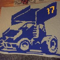 """My mom's Christmas present is almost done!! Don't tell her if you know her! This thing is a beast, it clocks in at 93.5""""x68.5"""" All those ends still have to be woven back in before it's done though 😭 #crochet #c2ccrochet #graphgan #stitchfiddle #sprintcar #minisprint #bestchristmasgiftever"""