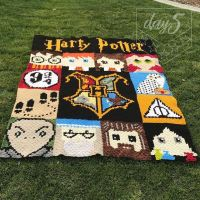 """HARRY POTTER AFGHAN!!!!! DayKid 2 chose a Harry Potter theme for her special blanket I make for her. I asked her why she chose Harry Potter and she said """"I love the movies, action, teamwork, characters, love, friendship, fighting evil, strength, magic, courage, believing in other people/yourself."""" Those sounds like some amazing reasons to me!! I love that she has been inspired by so many different values and characteristics in this story. For the design, I found all of the graph patterns for the squares on Pinterest. I don't know the individuals who designed each square, otherwise I would give them credit. All of the patterns were then uploaded into @stitchfiddle and I was able to alter or edit them for my needs. There are literally dozens of these squares out there of every character or special feature you can imagine in the stories. I worked with my daughter to narrow down the squares that she wanted for her blanket design and I even allowed her to choose where everything would be placed in the final design. It took me about 6 months to complete (not exclusively since I worked on it here and there while life was also going on). Crocheted using the Corner to Corner (c2c) method with graph patterns. Each of the smaller squares is 18"""" x 18"""". Making this Afghan 72 inches wide by 90 inches tall (6ft x 7 1/2ft). 20 Total colors of yarn were used. Each piece was crocheted together separately, and then hand sewn together. I honestly have no idea how much yarn I used, and how many hours I actually worked. But, it doesn't matter.....What does matter is the smile on DayKid 2's face, the excitement she has expressed and how much it means to her. THAT is what makes this all worth it!!! #day5creates #harrypotter #harrypotterblanket #graphgan #graphpattern #crochet #cornertocornercrochet #c2c #yarn #graphcrochet #sacramentosmallbusiness #harrypotterafghan #hogwarts #griffyndor #hufflepuff #ravenclaw #slytherin #hogwartshouses #hogwartscrest #hermione #hermionegranger #ronweasley"""