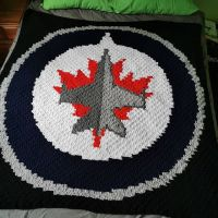 The second #winnipegjetsblanket is done and will be shipped out today! Now onto #oilers and #canucks . . . #nnchandmade #stitchfiddle #cornertocornercrochet #c2ccrochet #loopsandthreadsimpeccable #winnipegjets #nhlblanket #hockey #yarncanada #yarnspirations