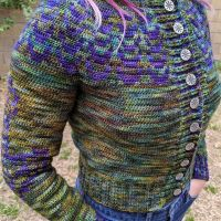 My #quillcardigan is done...after something like 80hrs. I added #helmofawe buttons from TreasureCast on Etsy. #malabrigoyarn I also used #stitchfiddle to create a Nordic Hammer motif for the sleeves because #swolemaidens must represent!