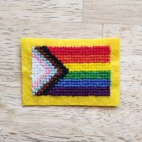 In my breaks between making scrubs, I have been working on the second cross stitch pattern I have ever designed based on Daniel Quasar's inclusive pride flag ✨ • I'd like to do more research into the best sites / programmes for cross stitch pattern creation but liked how easy it is to use the free functions on Stitch Fiddle and really happy with how this has come out after playing around with it. • I used waste canvas to stitch the design onto felt - the quality of the felt meant it was quite tough stitching and the stitches warped the fabric quite a lot but I'm happy with the design for a first go. • For once I also trimmed the waste canvas too close to the design so pulled some of the threads a bit but again, generally happy with it. • #crossstitch #crossstitchersofinstagram #stitchersgonnastitch #covidcrafting #stayinsideandstitch #crossstitchproject #crossstitchcreations #inclusiveprideflag #pride🌈 #proudtobeanally #lgbtqplus #inclusivity #danielquasar #stitchfiddle #customcrossstitch #madebyme #handmadewithlove