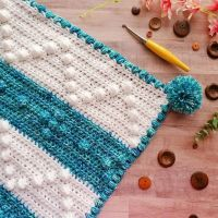 💙Pattern Release💙 Hera baby blanket pattern now is on the blog as a freebie. Hooray! I love how it turned out. Bobbles and puffs galore plus pom poms.....yes! I think I'll have to make a few more baby blanket patterns. This was really fun and I finished it in 3 days. Be awesome and Happy Wednesday! . . Yarn- I Love This Yarn in White and Deep Sea Diving . . Hook- @furlscrochet . . Pattern- Hera Baby Blanket 💙link in bio💙 . . . . #crochetersofinstagram #creativecrochet #calledtobecreative #crochetaddict #yarnbenders #crochet #patternmaker #wipwednesday #crochetgirlgang #craftsposure #crocheter #diy #ilovecrochet #yarnstagram #crochetlife #moderncrochet #handmadewithlove #makerlife #crochetanddo #crochetlove #calledtocreate #moderncrochet #crochetallday #crochetflatlay #patternrelease #yycrochet #bobble #wecrochet #babyblanket #baby #stitchfiddle