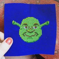 I mean, why wouldn't the first cross stitch pattern you ever design yourself be Shrek....? • Made this into a patch for the amazing @clairejoines, swipe to see what she might do with him... • #shrekisloveshrekislife #shrexy #shrek #ogreshavelayers #crossstitch #stitchersofinstagram #funnycrossstitch #popcultureembroidery #crossstitchmerch #stitchfiddle #originaldesign #dreamworks #literally #shrexappeal