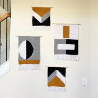 Of all the wall hangings I've done, this series is my absolute favorite. I call it the Abstract Series! Which is your favorite piece? I'm looking for testers for these wall hangings and the others I've posted (and not yet posted!) The link to apply to be a tester is in my bio! The actual pieces will be for sale first @wilsongirlsllc at the end of the month! • • • • #crochet #crochetwallhanging #crochetlove #wallhanging #yarnart #yarnlove #crochetaddict #wallart #walldecor #tapestrycrochet #crochetersofinstagram #bipoccrocheters #blkmakersmatter #blackcrochetersofinstagram #moderncrochet #stitchfiddle #makersgonnamake #homedecor #impeccableyarn #redheartsupersaver #intarisa #intarsiacrochet #patterntesterswanted #patterntestersneeded #patterntestercall #bigtwistyarn